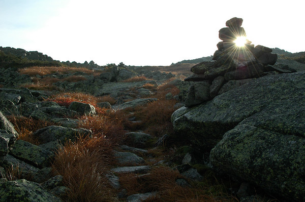The morning sun peeks through the gaps in a carin on the upper reaches of the Israel Ridge Path.