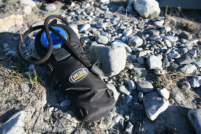 This CamelBak hydration system has served me well. The insulated cover over the hose and around the bag does stay the cold off somewhat, though I've been in some very cold situations where even blowing the water out of the tube and back into the bag hasn't helped. The D-rings are great for strapping the CamelBak on as needed and with a piece of webbing can even be a pack on it's own. More review info at offyonder.com.