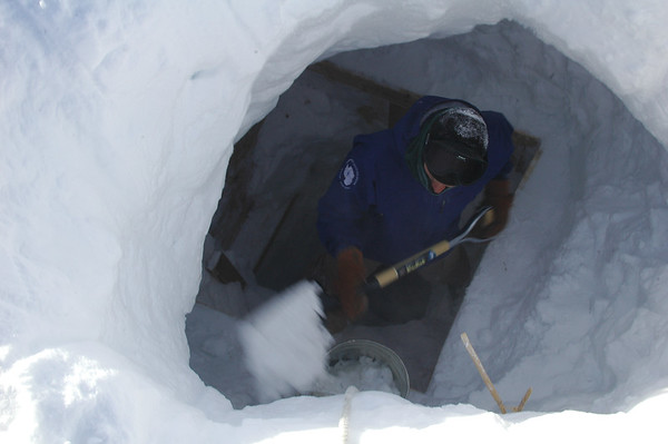 SOUTH POLE, ANTARCTICA: There is still some cleaning up to do around the edges in the 7 meter hole down to the cockpit hatch.