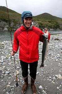 KONGAKUT RIVER, AK - Camp II: North Bend; Nathaniel hooks a 5 pound arctic char for dinner.