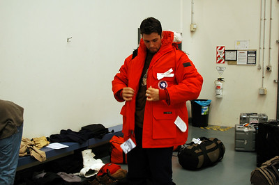 CHRISTCHURCH, NEW ZEALAND: Extreme cold weather gear issue to head to the Antarctic. Bryan tries on his heavy parka.