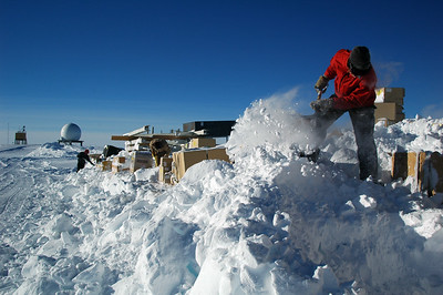 SOUTH POLE, ANTARCTICA; Tony stands on a pile of snow that needs to be moved off the berm and into the road for the dozer to come by and plow out of the way.
